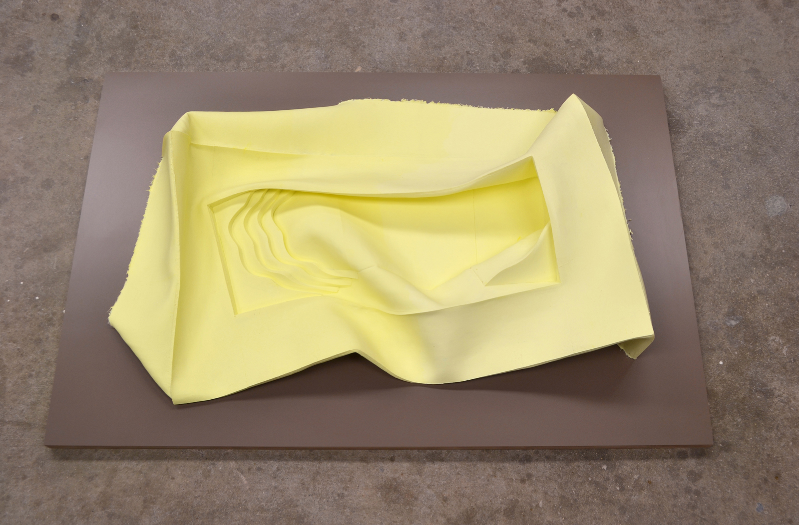John Dickinson, Yellow Pool, 2015, silicone, laminate, 30 x 40 x 5 in. Courtesy of the artist.
