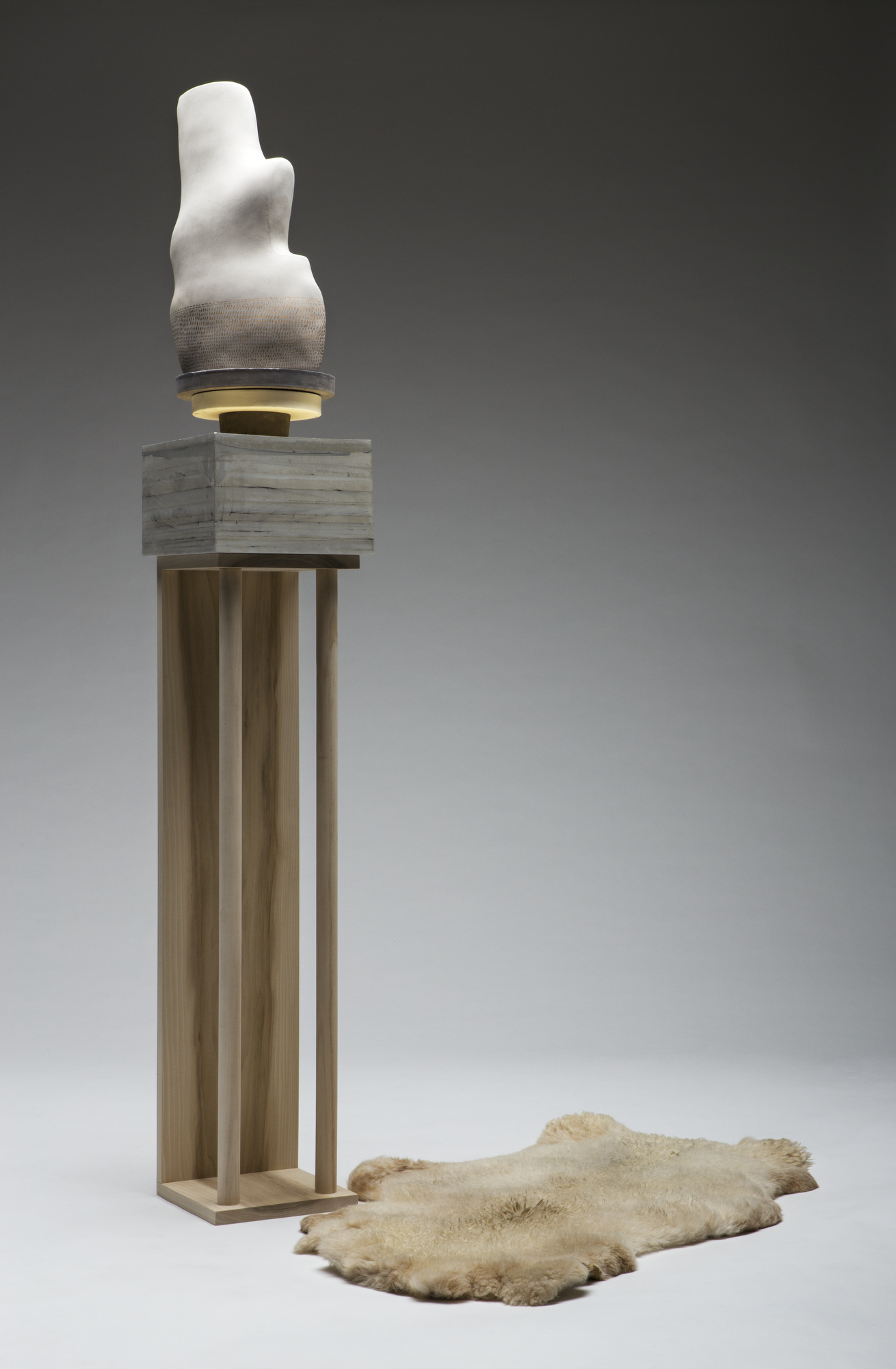 Christy Wittmer, Meridian, 2016, ceramic, cement, wood, gold leaf, gold luster, sheep skin. Courtesy of the artist.
