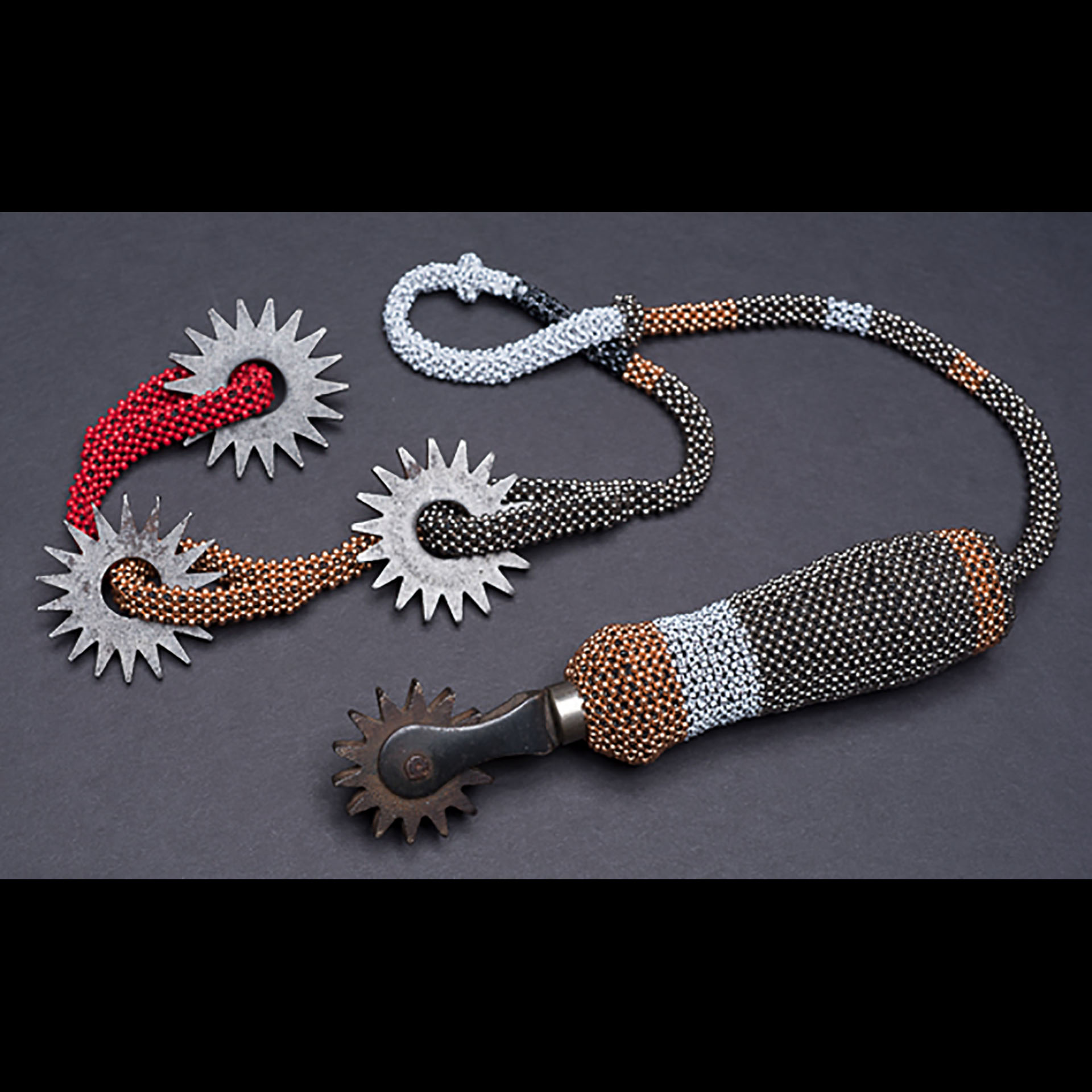 """Detachment Device; 2016; 28.5"""" x 1.5"""" x 1.5""""; Beadwork assemblage; Vintage hand tool; seed beads; thread; metal disks. Right-angle-weave beadwork."""