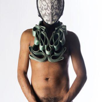 "Matt Lambert, untitled (mask4mask), Digital Print, 48""x36"", continuous tow straps, steel, upholstery textile, cotton. 2016. PC: Alyson Williams."